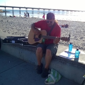James McGarvey playing at Ocean Beach